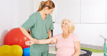 caregiver doing massage in the hands of patient