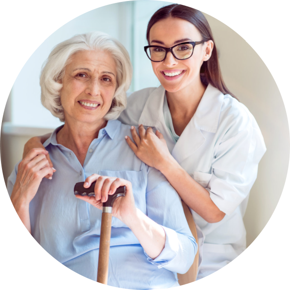caregiver holding the hands of senior patient